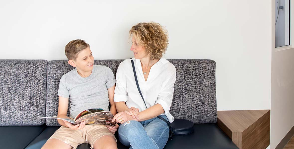 Mother and son sitting at Whites Dental Care dentist in Neutral Bay reception image